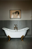 Classic, free-standing, clawfoot bathtub in modern bathroom