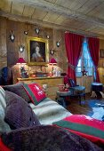 Painting and hunting trophies in comfortable chalet living room