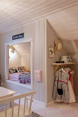 Cubby bed below sloping ceiling in child's bedroom