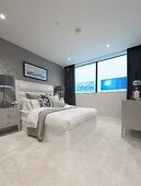 Pale carpet and double bed in elegant bedroom