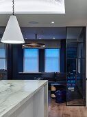 Marble kitchen island and living room in shades of blue and black