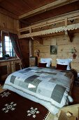 Rustic bedroom in chalet with wooden walls