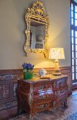 Antique chest of drawers and mirror in Château des Grotteaux