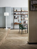 Spit-level interior with partition wall and herringbone parquet floor