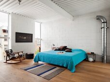 Double bed with blue cover