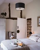 Breakfast tray on bed in rustic bedroom