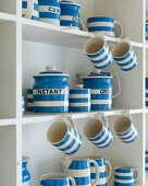 Collection of blue and white crockery in dresser