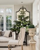 Period furniture and Christmas trees in elegant living room in shades of grey