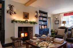 Wood-burning stove in fireplace of festively decorated, traditional interior