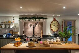 Island counter and Christmas decorations in traditional country-house kitchen