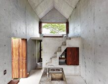 Purist, modern architect-designed house made from wood and concrete