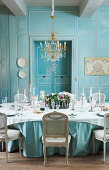Festively set table in antique dining room with panelled walls