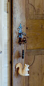 Wooden door with squirrel pendant hung from key