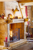 Rustic open firepalace with wooden surround in chalet