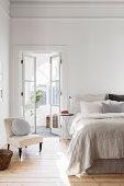 Bright bedroom with an open double door to the winter garden