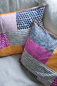 Multicoloured scatter cushions on sofa