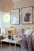 Cosily lit living room with wintry accessories