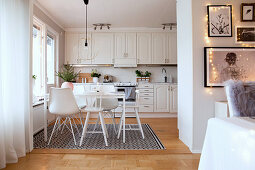 White kitchen-dining room in country-house style