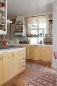 Old kitchen with yellow panelled cabinets in Scandinavian country-house kitchen