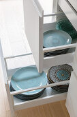 Turquoise crockery in drawer