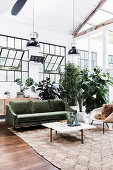 Living room in the loft with factory windows and houseplants