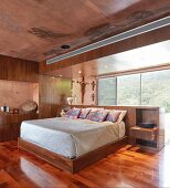Modern bedroom in red concrete and wood