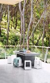 Minimalist balcony with screed, concrete table and view of the forest