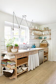 Wooden, country-house-style kitchen counter with open-fronted shelves