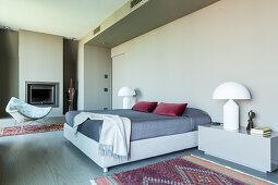 Designer furniture in elegant bedroom in shades of grey