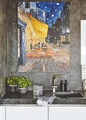 A large painting on a stone-coated wall above a sink
