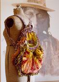 Rucksack made from colourful velvet and ruffles on tailors' dummy