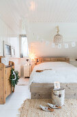 Christmas decorations in comfortable bedroom in natural shades