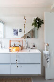 Simple Christmas decorations in white modern bathroom