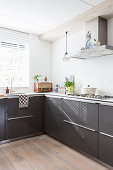 Vintage accessories in modern kitchen flooded with sunlight