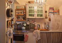 Wall-mounted shelves and cabinets in cluttered kitchen