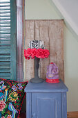 Fabric flowers on lampshade of bedside lamp