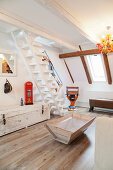 Wooden furniture and white staircase in attic living room