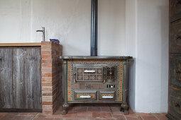 Antique kitchen cooker next to masonry kitchen counter