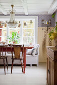 Old chairs at red table in Scandinavian country-house kitchen