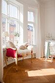 Sheepskin on Baroque couch below window in round room of period interior