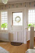 Front door and lattice windows in Scandinavian country-house-style foyer