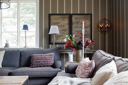 Cosy living room in shades of grey with striped wallpaper