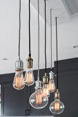 Various pendant lamps with light bulbs of different shapes