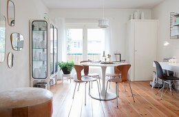 Classic designer furniture in dining room with retro ambiance
