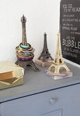 Three small Eiffel Towers used as jewellery racks and ornaments