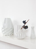 White structured vases on shelf