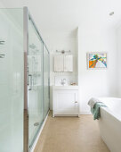 Long, narrow shower cubicle in white modern bathroom