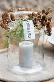 DIY candle lantern decorated with larch cones