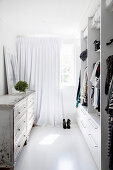 Dressing room with modern closet and vintage chest of drawers