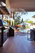 Covered terrace with outdoor kitchen, pool in the background